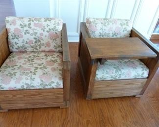 couple of vintage chairs with a removable wooden tray.