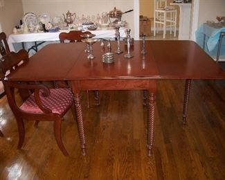 Cherry dining table with tobacco twist legs; the sterling pieces.