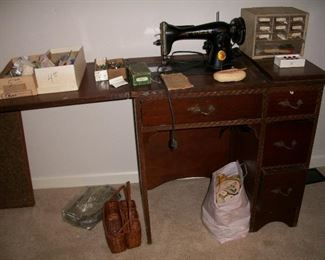 Vintage Singer sewing machine in cabinet