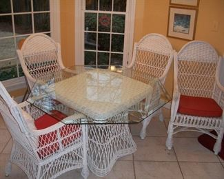 Wicker dining table with glass top and four chairs