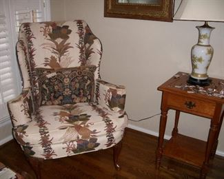 One of a pair of upholstered chairs