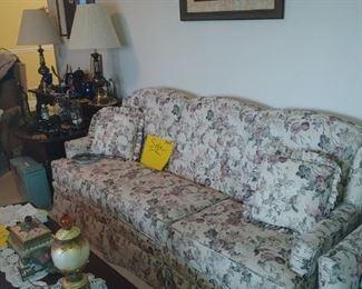 Pretty floral sofa has matching chair.
