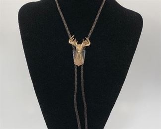 Bolo - 14KT Buck with marquis cut diamond eyes.