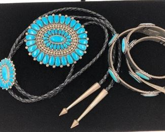 "Lorraine Waatsa, Zuni jewelry artist featured published in ""Zuni Jewelry"" for her cluster work. Fox Mine turquoise buckle, turquoise bolo, turquoise hat band all set in sterling silver"