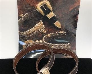 Holland's #103 sterling and 14kt four-piece belt set on hand tooled strap.