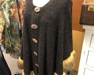 Faux fur trimmed sweater/cape.