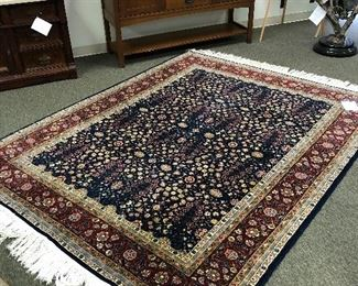 Hereke 6x9 wool and silk Turkish rug.