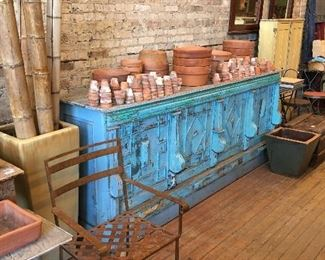 Blue vintage counter, cabinet, primitive. Flower pots. Wrought iron tables and chairs.