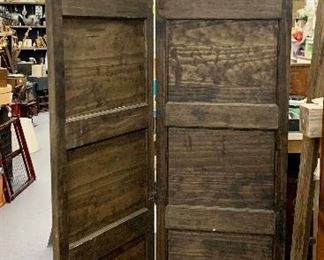 Folding Solid Wood Paneled Doors are hinged