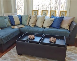 L Couch Leather and spill resistant slate weave slip covered bottom cushions and leather back pillows.