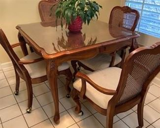 Hooker brand table and chairs on casters.