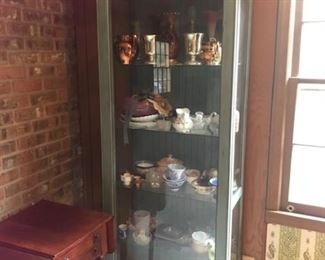 Curio cabinet with sliding door
