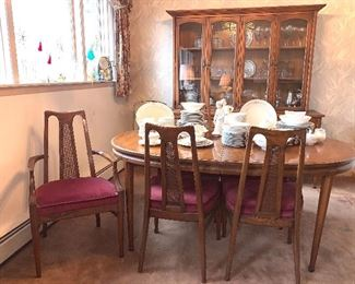 Dining room table with two leaves and six chairs. Also has matching lighted hutch
