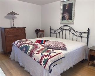 King size wrought iron bed and bedding