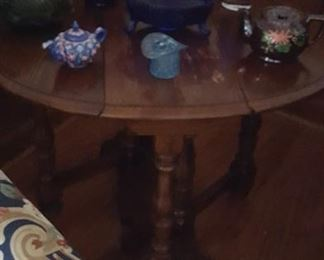 Round gateleg table and cobalt glass