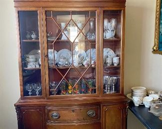 Solid Wood China Cabinet:  Clear Glass, 3 Shelves, 3 Drawers, 2 Cabinets, each Cabinet has 2 Shelves.  Displayed in the Cabinet assorted Japanese inspired dishware, silver goblets.