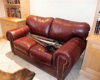 RED LEATHER LOVESEAT