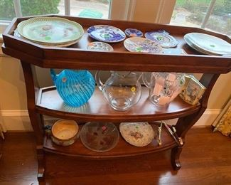 Great side table and vinatge dishes.