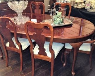 One of two lovely dining tables with 6 chairs --- complete with leaves and pads