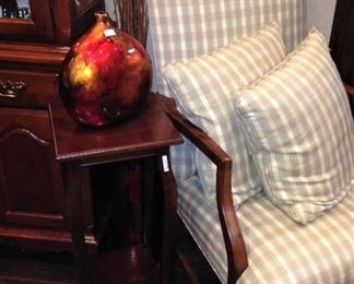 Upholstered arm chair and side table