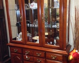 This large china cabinet offers  more than ample storage and display space.
