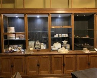 "Antique Oak Store Display Cabinet-2 Sections, 20' 10"" Long, 36"" Depth, Height of Base 32"", 93"" Tall, 14 Doors.  There are 6 Glass Doors That Extend Upwards 52 Additional Inches From Cabinet (1 Missing), Lighted Case"