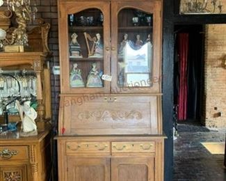 Lot 807 Antique Oak Cabinet 98 x 42 x 19- Cabinet has a Drop Front, 2 Drawers, 4 Doors.  5 Pieces Carnival Glass, 10 Figurines.