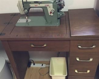 sewing machine in cabinet