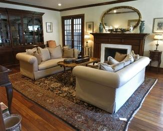 Living Room: Pair of Down Silk Sofas; Large Mahogany Library; Antique Kirman Rug, 11 x 13'8