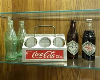Antique Coca Cola carrying tin and bottles