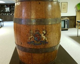 Antique oak English beer barrel with the English Coat of Arms