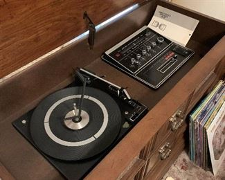 Cabinet stereo:  am/fm, record player & 8-track