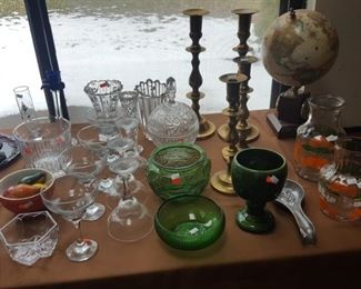 Brass Candlesticks, vintage glass water pitchers, various crystal pieces.