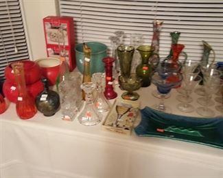 Various colored glassware, ashtray, vintage planters.