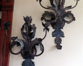 Hand wrought metal sculpture sconces.