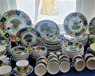 Large set of colorful Mexican pottery dishes.