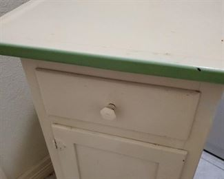enameled top cream and sage cabinet