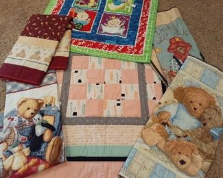 Dozens of hand-crafted quilts, baby motif shown