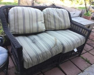 Settee with cushions need clean but sunbrella fabric good,  matches table and chairs