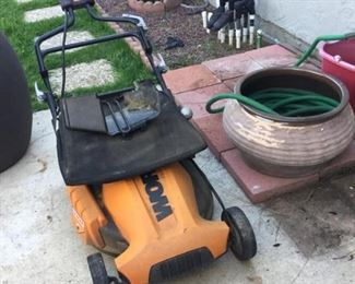 Folding lawnmower for small space storage