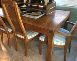 He recon dining table with six chairs, caned back, two arm chairs have back upholstery that matches seats