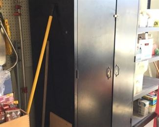 One of two large black storage metal cabinets