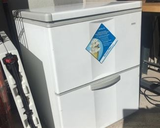 Chest freezer with lower drawer
