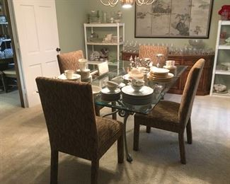 Glass top dining table and 4 upholstered chairs