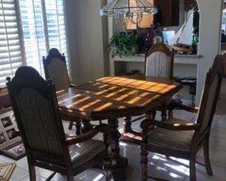 Dining room table with six chairs and matching secretary