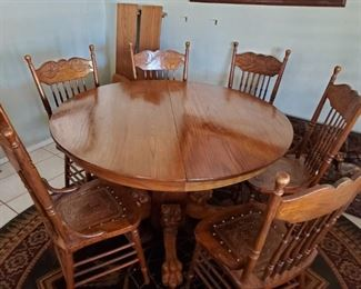 """Antique oak table 6 chairs and 2 leaves, 48"""" diameter. $500"""