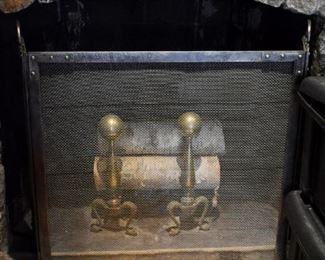 Fireplace screen and brass andirons