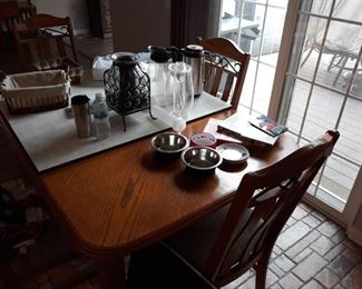 Oak and Iron Dining Set with Home Decor