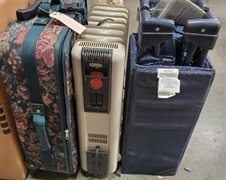 Floral Print Suitcase, Pack-and-Play and Space Heater Floral Print Suitcase, Pack-and-Play and Space Heater