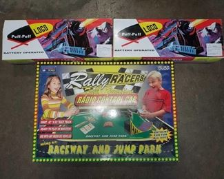 Raceway and Jump Park, 2 Battery Operated Toy Train Raceway and Jump Park, 2 Battery Operated Toy Trains. All Toys are in original box, brands include Puff-Puff LOCO, and Rally Racers